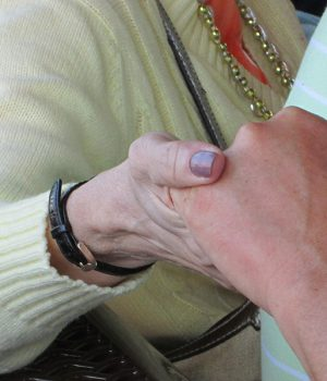 Kreider Services - holding hands